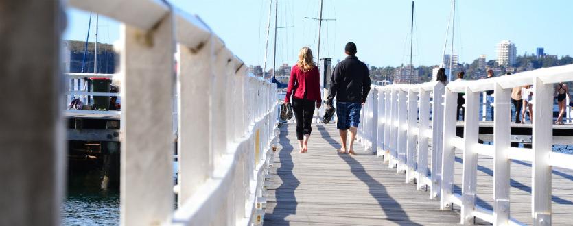 Couple walking on pier in Mosman, Sydney