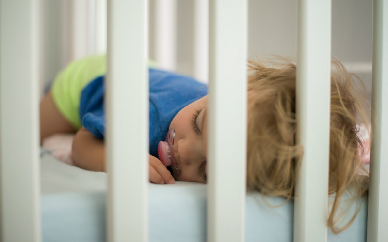 child sleeping in crib