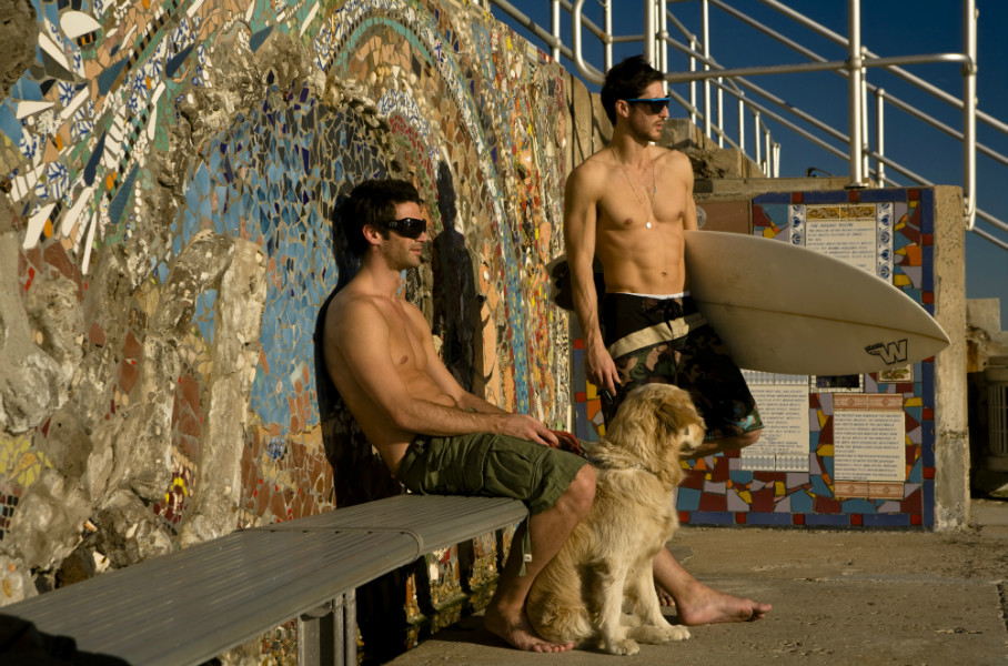 Surfers with their dog at Bondi Beach, Sydney.