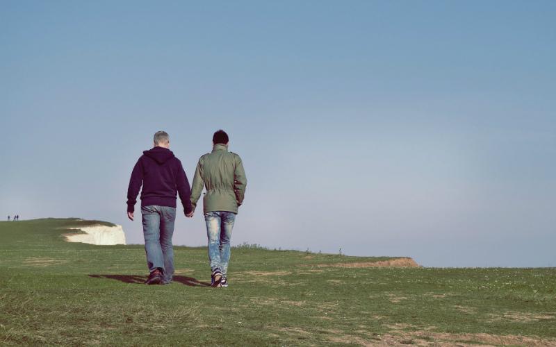 couple walking across grass
