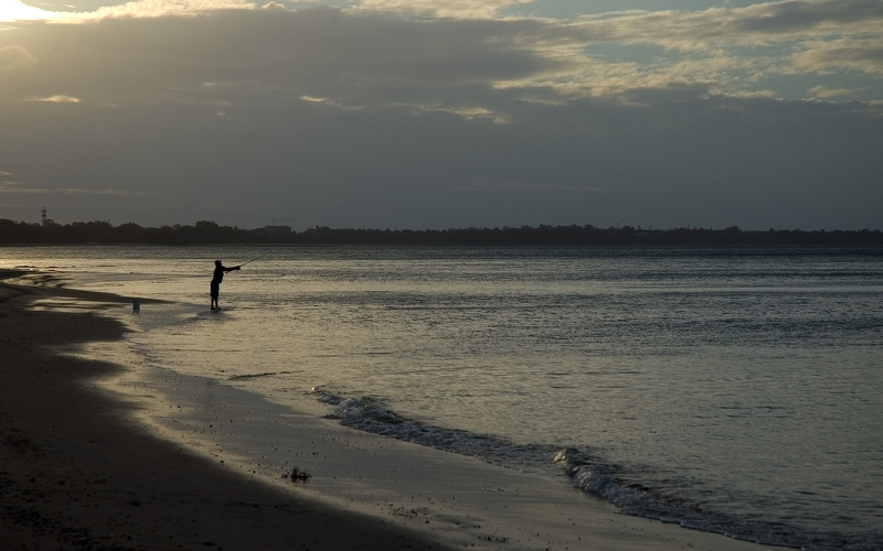 fishing at sunset in hervey bay queensland