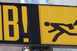 Pickpocket warning. Image Credit: Cornelius Kibelika