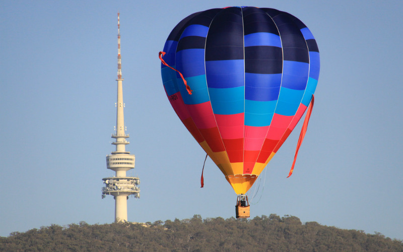 A hot air balloon floating above Canberra