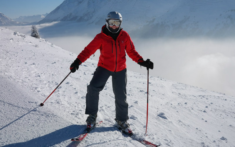skiier in red on snow