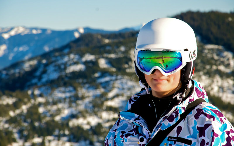 woman in ski gear with goggles and helmet