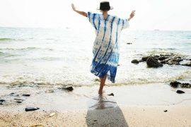 woman on beach in striped dress