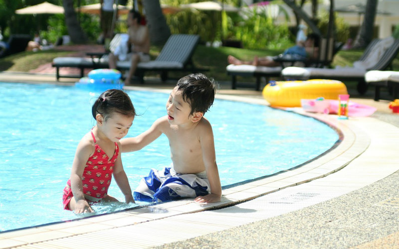 boy girl children swimming pool