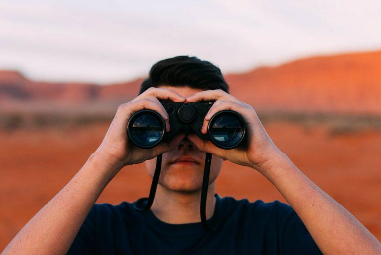man with binocullars