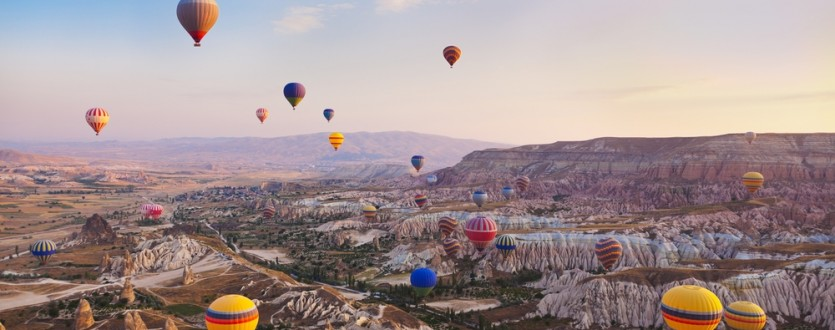 Float above the gorgeous landscape of Cappadocia in Turkey.